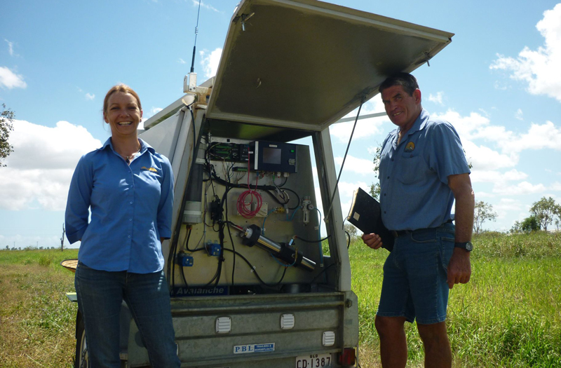 Dennis (BBIFMAC) and Lisa (NQDT) run water samples from Horseshoe Lagoon through the 'Real Time Water Quality Trailer' to test water quality