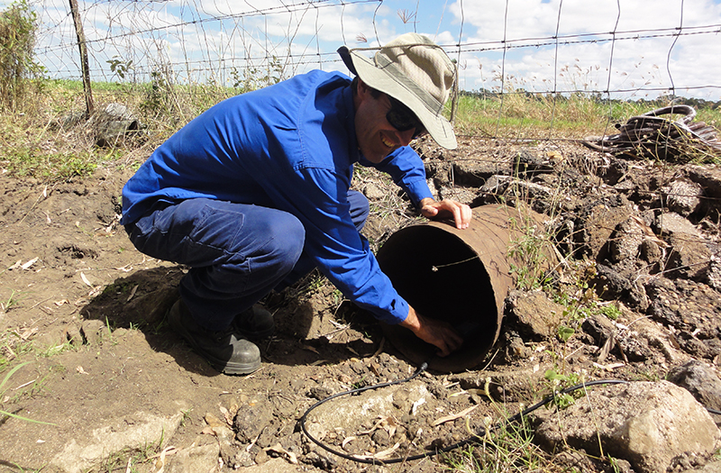 NQ Dry Tropics Technical Officer, Paul Godfrey, installing water monitoring equipment into a tail water pipe in preparation for an upcoming irrigation event.