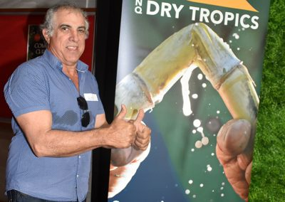 Clare sugar cane grower Glen Pirrone shows off the thumbs that feature prominently on a new NQ Dry Tropics banner.
